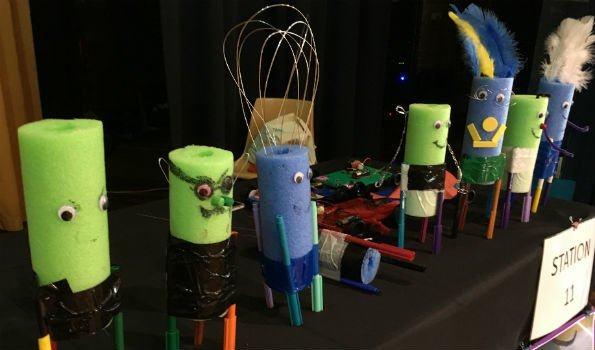 Scribblebots made of pool noodles with human like features on its face