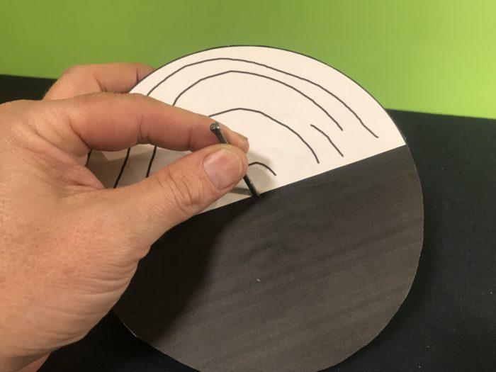 Benhams disc science experiment - pushing the nail through the disc