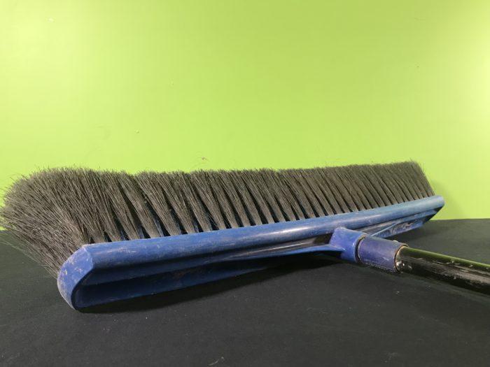 Broom balance science experiment - a regular broom