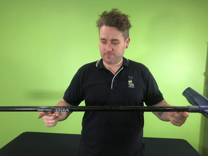 Broom balance science experiment - balancing the broom with arms apart