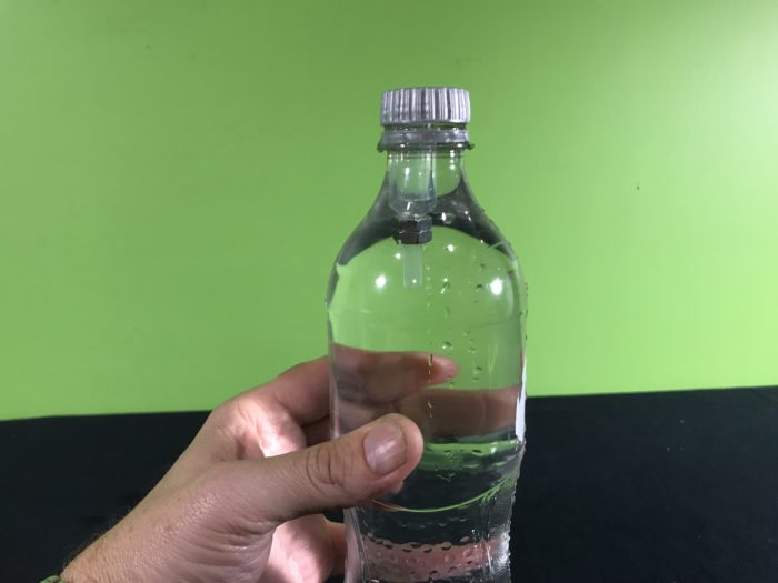Cartesian diver science experiment - pipette floating before squeezing the bottle