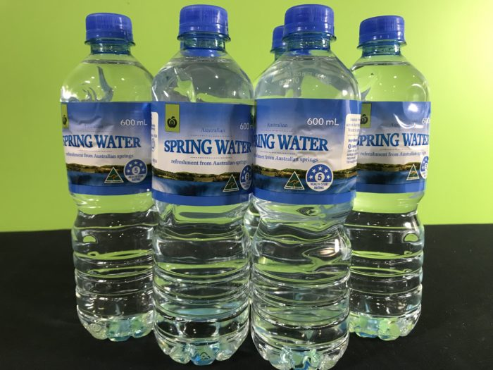Supercool water science experiment - bottles of spring water