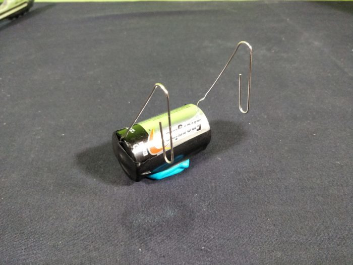 Make a Simple Motor - add copper coil to paper clips making sure that the sanded copper touches the paperclips