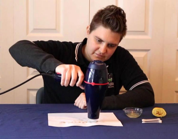 Lemon juice Christmas cards science experiment - using a hair dryer to heat the lemon juice writing