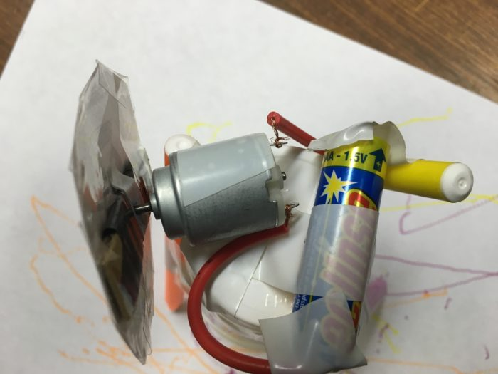 Make a scribblebot science experiment - top of scribblebot showing battery and motor attachment