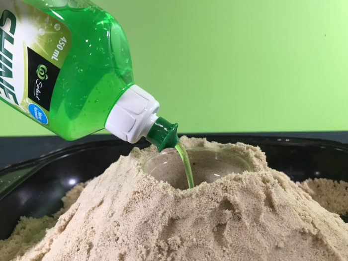 Make a volcano science experiment - adding detergent to the sand volcano (1)