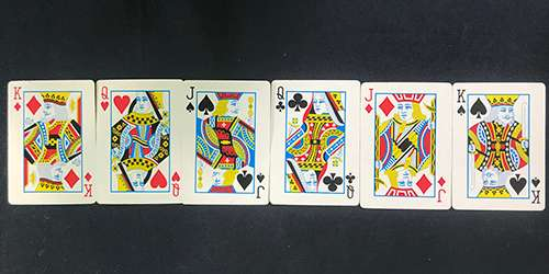 Row of playing 6 cards