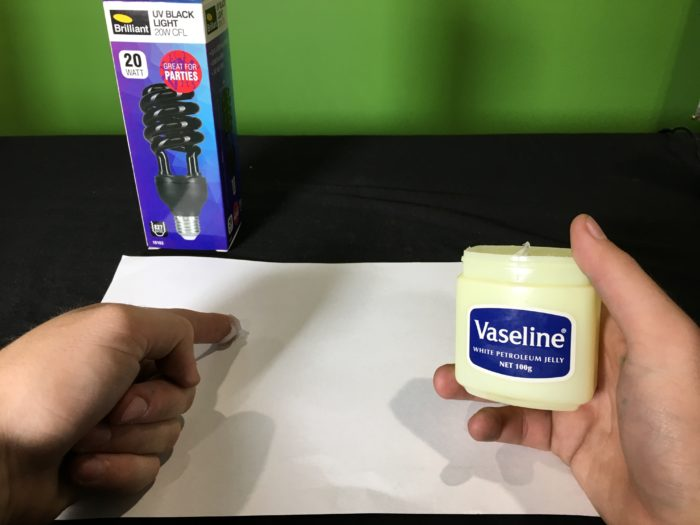 Secret glow in the dark science experiment - rubbing vaseline on paper