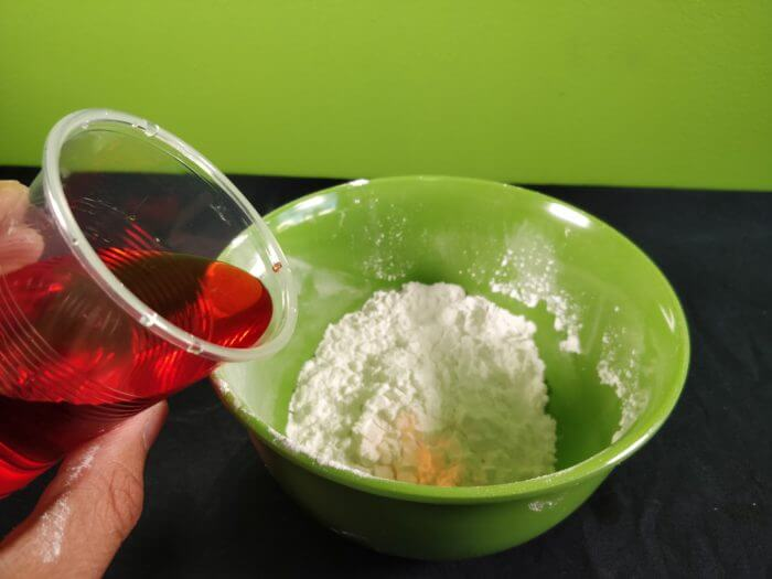 adding of food colour on the bowl of cornflakes