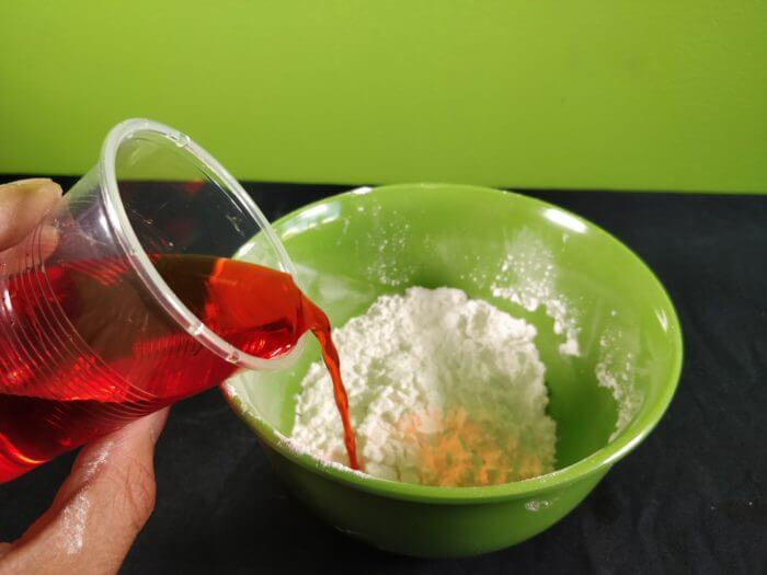 adding more food colour on the bowl of cornflakes
