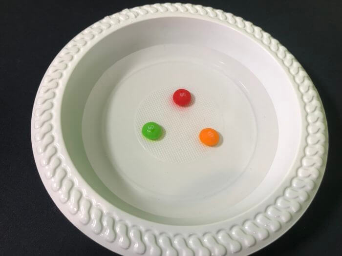 Skittle science experiment - position of skittles in the water