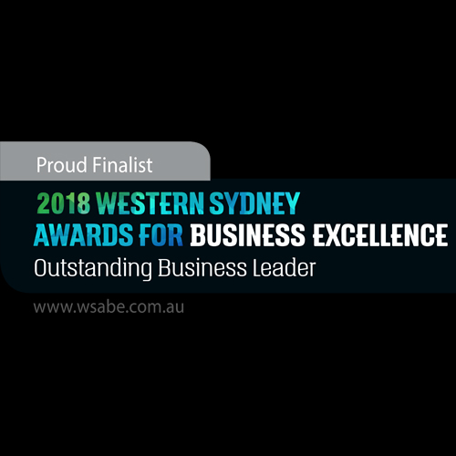 blue green and white text saying 2018 WSABE Excellence Outstanding Business Leader with a black background