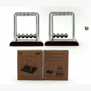 Two Newtons cradle with their cardboard boxes below them
