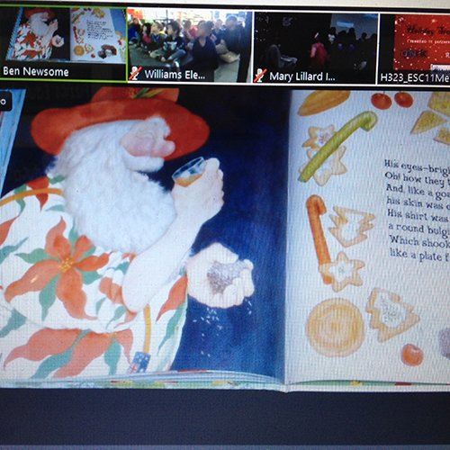 "An open book showing the text of the book ""Aussie night before Christmas"" during a video conference to US schools"