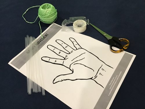 The materials seen in the picture are straw, paper,scissors, string and tape.