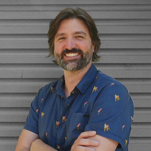 Michael Kasumovic standing in front of a garage door