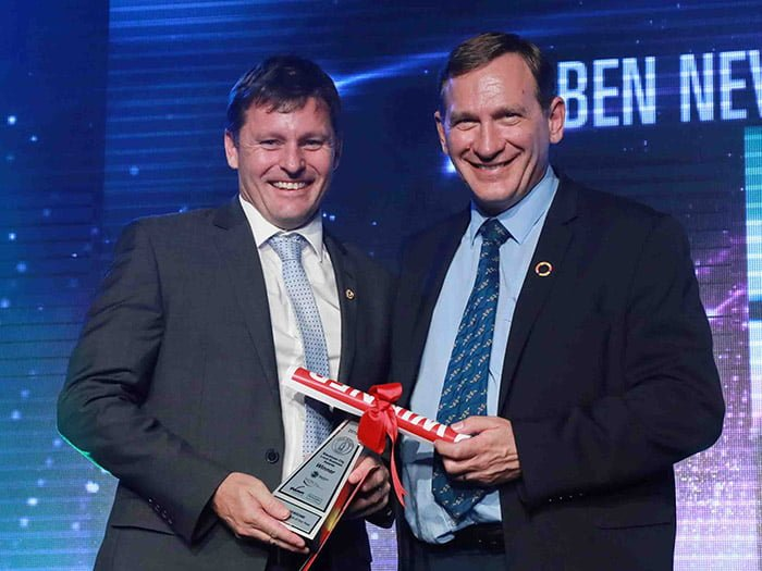 Ben Newsome on stage with Mr Stephen Louis BALI MP