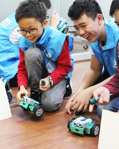 Two students smiling whilst using FlipRobotics