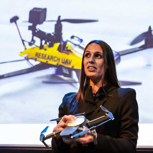 Dr Vanessa Pirotta with drone behind her on a slide