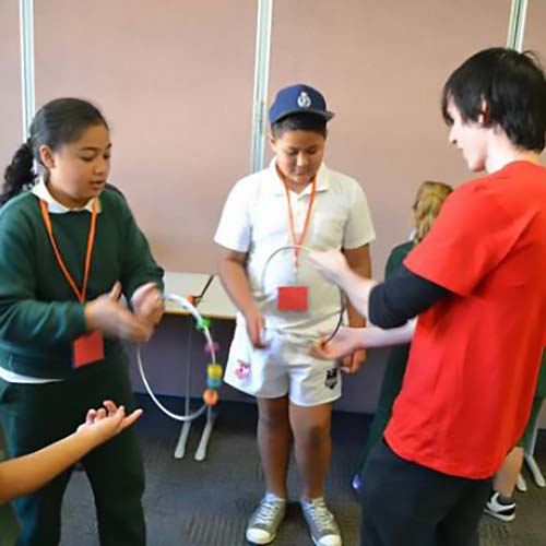 Students spinning yro rings during a Fizzics Education workshop
