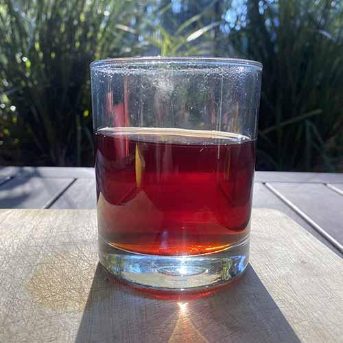 A glass of hot tea in sunlight