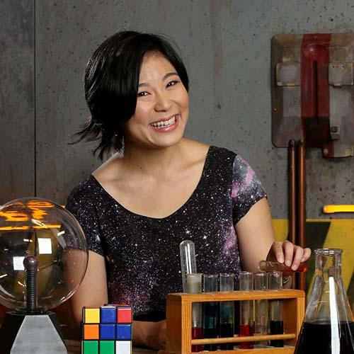 Isla Headshot behind a science desk