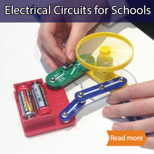 A series circuit showing a battery, switch & motor with fan made out of clipcircuit parts. Two hands are making the circuit