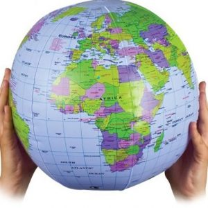 An Inflatable Globe held between two hands. Africa is shown with it's geopolitical regions identified.