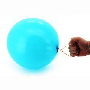 A blue punch ball with it's rubber band handle being held by a hand