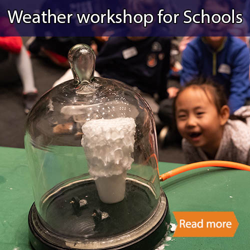 A bell jar with expanding shaving cream in it (kids are smiling whilst watching it grow)