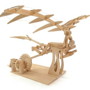 da vinci ornithopter, showing a wooden perons below a pair of wooden wings. The feet are psuhing on a lever that is attached to gears